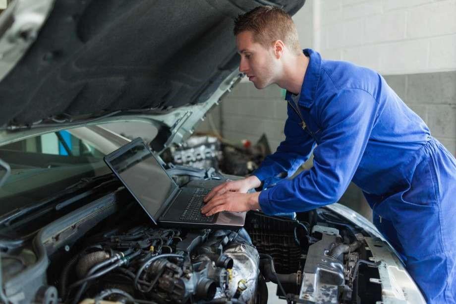 Auto Repari Techinician diagnosing car issue